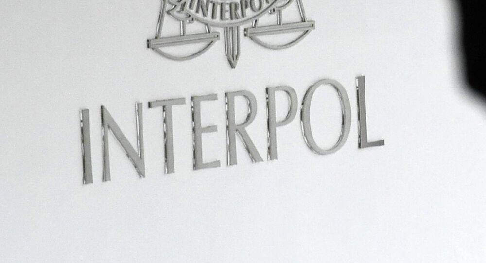 A logo at the newly completed Interpol Global Complex for Innovation building is seen during the inauguration opening ceremony in Singapore