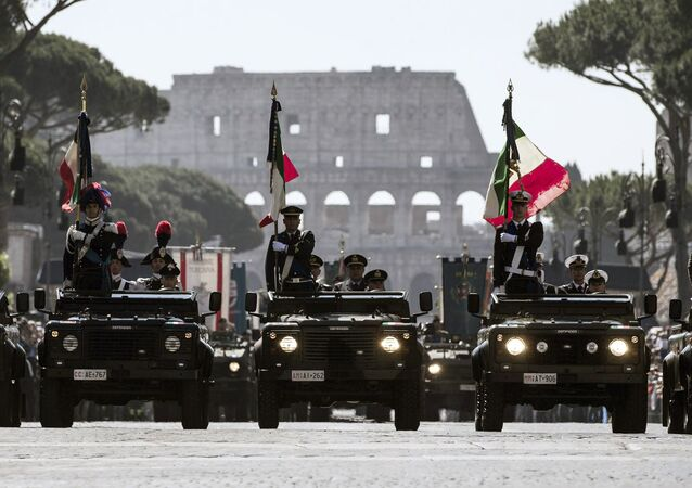 Members of the Italian Armed Forces are framed by the Colosseum, visible in background, in Rome, Tuesday, June 2, 2015 during the Republic Day parade.