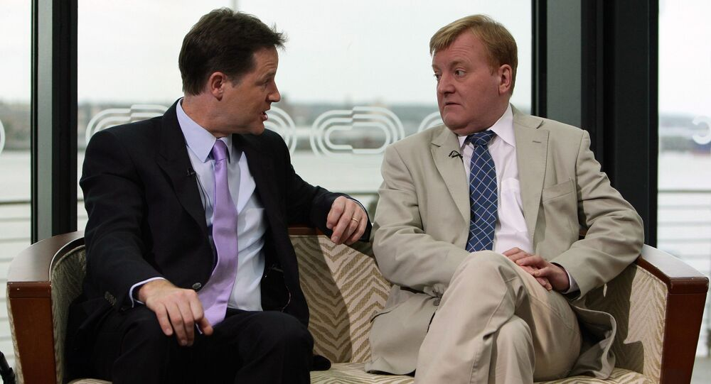 Former Liberal Democrats leader Charles Kennedy, right, speaks with leader of the Liberal Democrats Party, Nick Clegg, left.