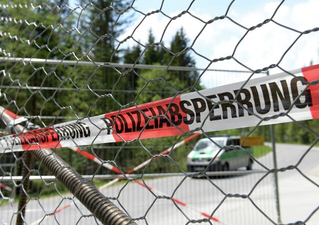 A police barrier can be seen in the small Bavarian village of Klais, southern Germany, at the access road to Schloss Elmau Castle near Garmisch-Partenkirchen