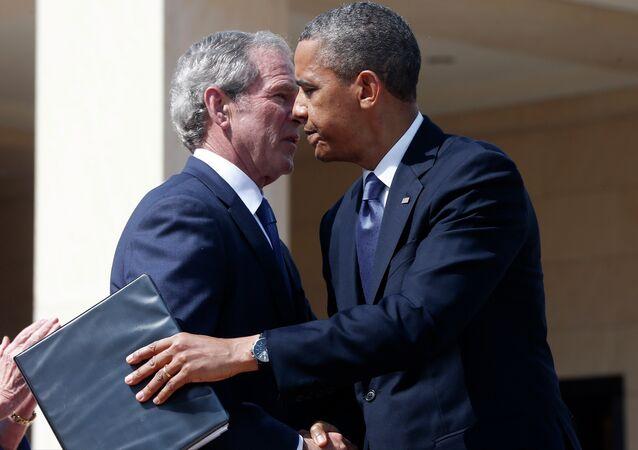 President Barack Obama embraces former President George W. Bush after he spoke at the dedication of the George W. Bush presidential library.
