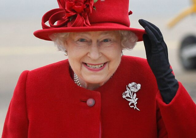 Britain's Queen Elizabeth II holds on to her hat in high winds as she arrives for a visit to RAF Valley, Anglesey, Wales, where her grandson Prince William, is stationed as a search and rescue helicopter pilot Friday April 1, 2011
