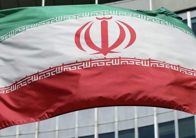 The Iranian flag flies in front of a UN building.