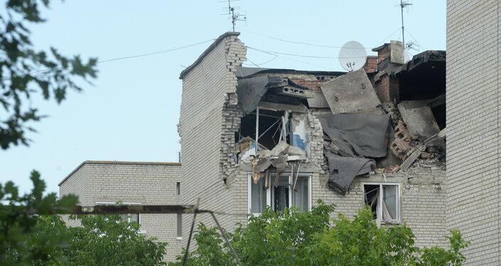 Residential building damaged by the artillery shelling of the city of Mayrinka near Donetsk by Ukrainian forces