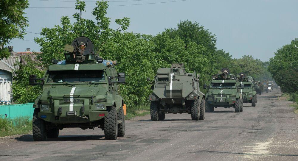 A convoy of Ukrainian armored vehicles move on the outskirts of Marinka, Donetsk region, eastern Ukraine