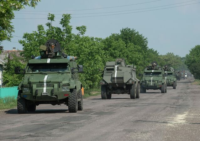 A convoy of Ukrainian armored vehicles move on the outskirts of Marinka, Donetsk region, eastern Ukraine