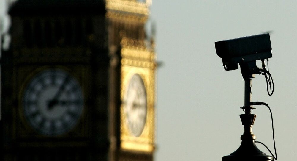 A CCTV (Closed Circuit Television) camera is seen against the backdrop of Big Ben in central London