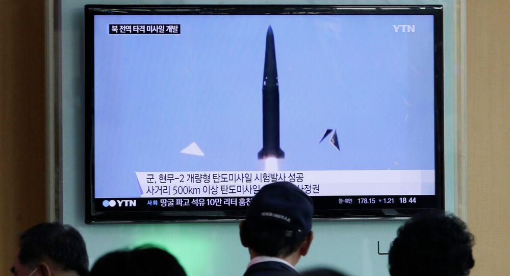 People watch a TV news program showing South Korea's missile test at Seoul Railway Station in Seoul, South Korea, Wednesday, June 3, 2015