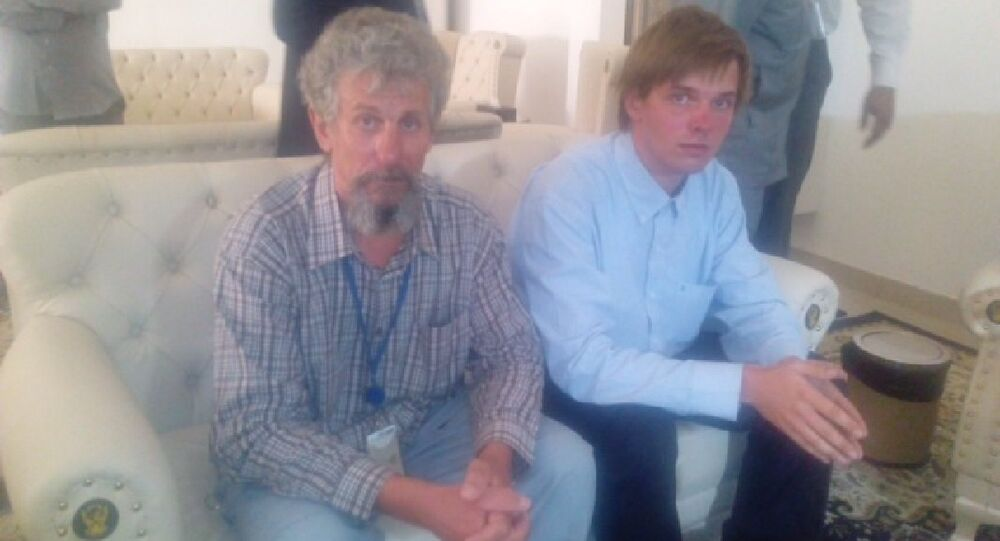 Sergei Cherepanov (L) and Mikhail Antyufeev, the two Russians kidnapped in Sudan's Darfur region in January 2015