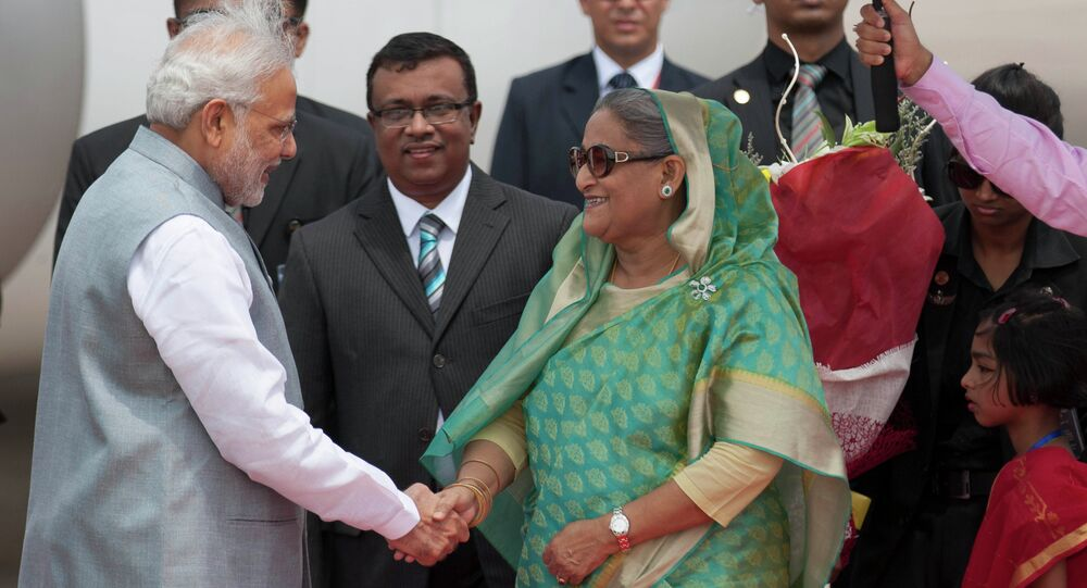 Bangladesh's Prime Minister Sheikh Hasina shakes hand with Indian Prime Minister Narendra Modi upon his arrival at the Hazrat Shahjalal International airport in Dhaka, Bangladesh, Saturday, June 6, 2015