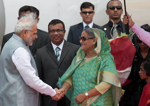 Bangladesh's Prime Minister Sheikh Hasina shakes hand with Indian Prime Minister Narendra Modi