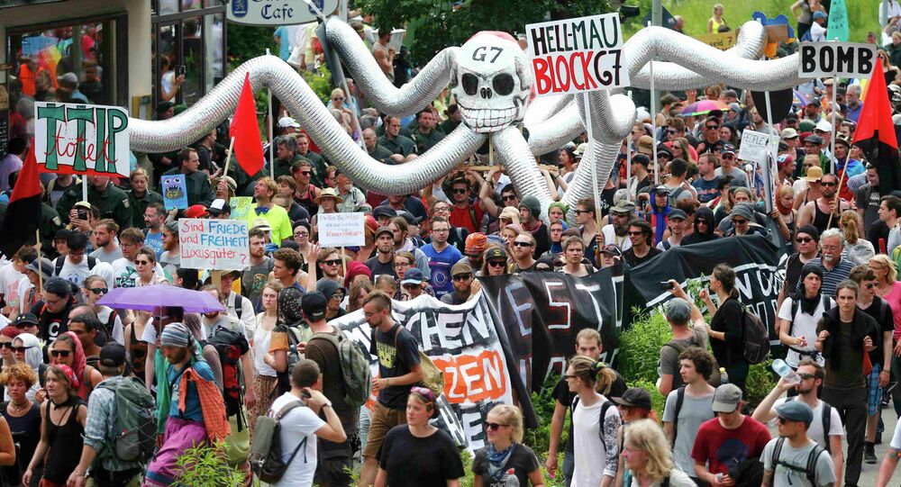 Anti-G7 protestors march during a demonstration in Garmisch-Partenkirchen, southern Germany
