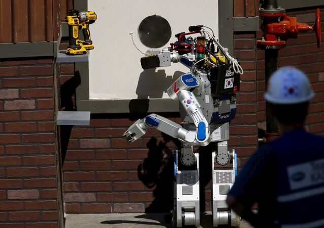The Team KAIST DRC-Hubo robot completes the cutting task before winning the finals of the Defense Advanced Research Projects Agency (DARPA) Robotic Challenge in Pomona, California June 6, 2015
