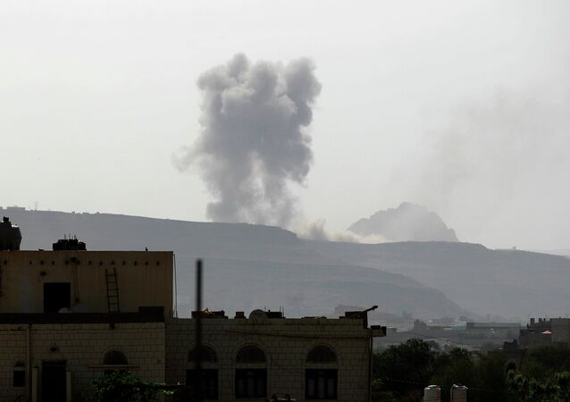 Smoke billows following an air-strike by the Saudi-led coalition on an army arms depot, now under Shiite Huthi rebel control on June 7, 2015