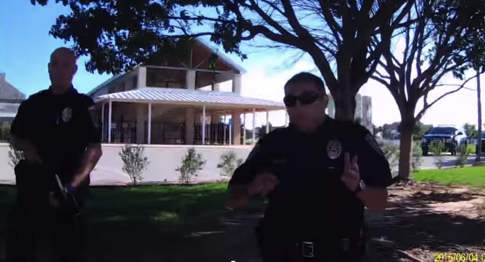Screeshot of officers approaching open-carry activists in Abilene, Texas