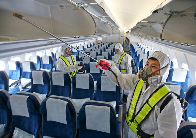 Employees from Korean Air disinfect the interior of its airplane in Incheon, South Korea, June 5, 2015