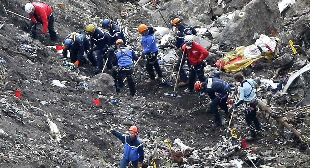 In this March 26, 2015 file photo, rescue workers work on debris of the Germanwings jet at the crash site near Seyne-les-Alpes, France