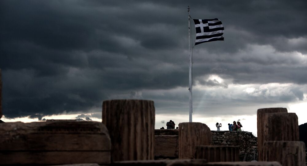A Greek flag waves in the breeze at Acropolis hill, in Athens on June 5, 2015