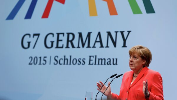 German Chancellor Angela Merkel holds a news conference during the G7 summit at Elmau Castle hotel in Kruen near Garmisch-Partenkirchen, southern Germany, June 8, 2015 - Sputnik International