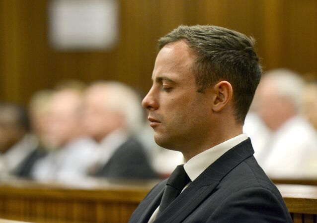 Paralympian Oscar Pistorius is seen during his sentencing for the killing of his girlfriend Reeva Steenkamp at the high court in Pretoria, on October 21, 2014