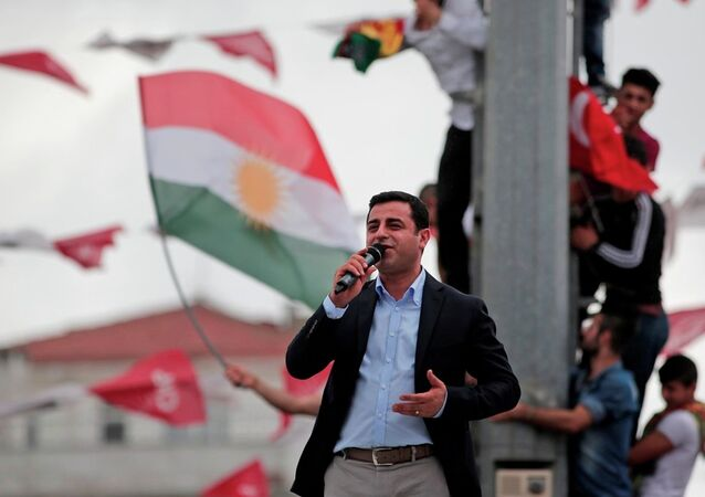 Selahattin Demirtas, co-chair of the pro-Kurdish Peoples' Democratic Party (HDP), delivers a speech from the top of his election campaign bus at a rally in Istanbul, Turkey, Saturday, June 6, 2015.