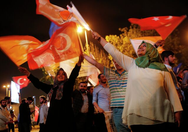 Supporters of Turkey's ruling Justice and Development Party celebrate after the election results in Istanbul, Turkey, late Sunday, June 7, 2015