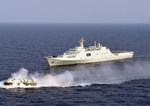 China's amphibious ship Jinggangshan is seen during a coordination training with a hovercraft in waters near south China's Hainan Province in the South China Sea.