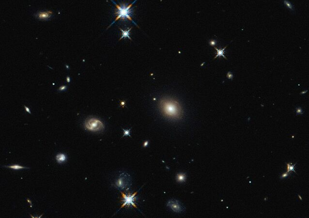 The image shows the foreground lensing galaxy (observed with Hubble), and the gravitationally lensed galaxy SDP.81, which forms an almost perfect Einstein Ring, is hardly visible.