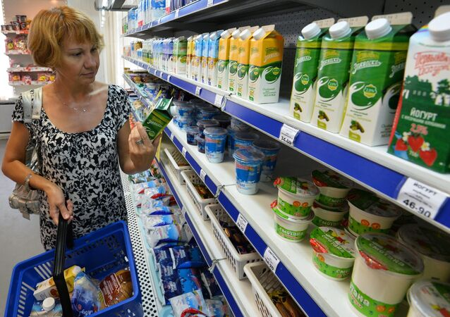 A buyer near the shelf with dairy products