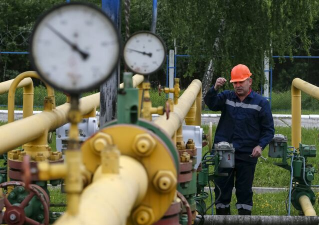 A worker checks equipment at an Dashava underground gas storage facility near Striy, Ukraine May 28, 2015