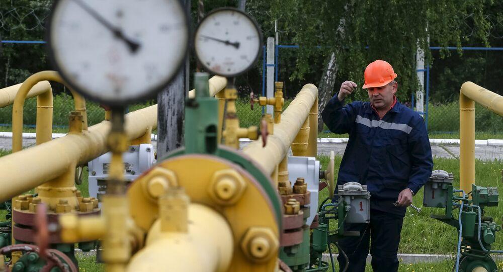 A worker checks equipment at an Dashava underground gas storage facility near Striy, Ukraine May 28, 2015