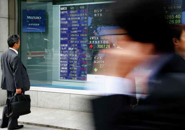 A man looks at an electronic stock indicator of a securities firm in Tokyo, Thursday, May 21, 2015