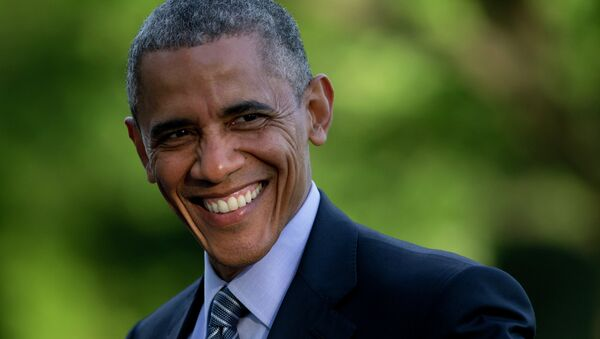 President Barack Obama smiles as he walks across the South Lawn to the White House from Marine One, Wednesday, May 20, 2015, in Washington - Sputnik International