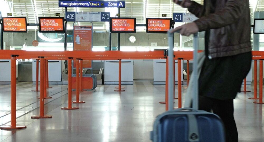 A traveller waits at Nice airport, southeastern France