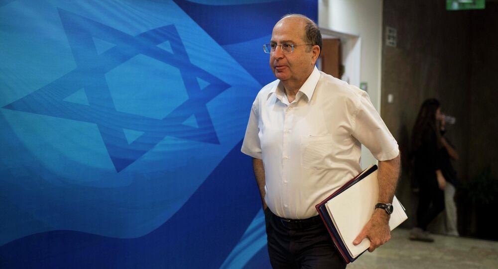 Israeli Defense Minister Moshe Ya'alon arrives for the weekly cabinet meeting at Prime Minister's Jerusalem office on October 26, 2014