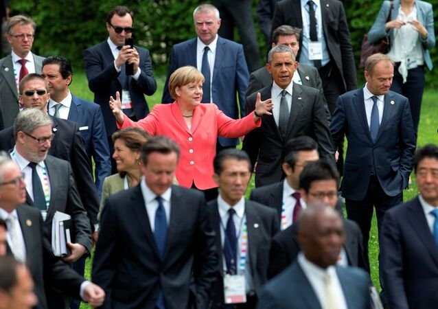 US President Barack Obama, center right, and German Chancellor Angela Merkel, center left, walk to a group photo of G-7 leaders.