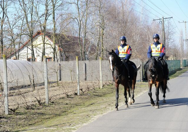 Mounted police officers patrol in the vicinity of Morahalom, 179 kms southeast of Budapest, Hungary, next to the Serbian border