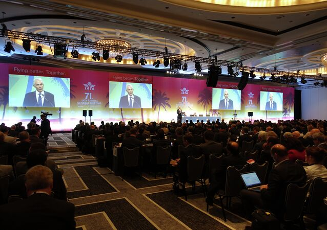 Global airline executives including Tony Tyler, director general of the International Air Transport Association(IATA), addresses the 71st IATA Annual General Meeting and World Air Transport Summit in Miami Beach, Florida on June 8, 2015