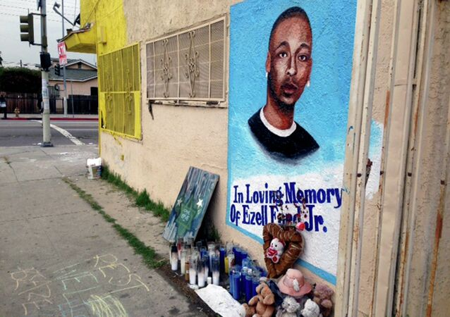 In this Dec. 30, 2014, file photo, a street side memorial with a painted portrait of Ezell Ford near where he was shot when police confronted him on Aug. 11, 2014, is shown on a street near his home in South Los Angeles.