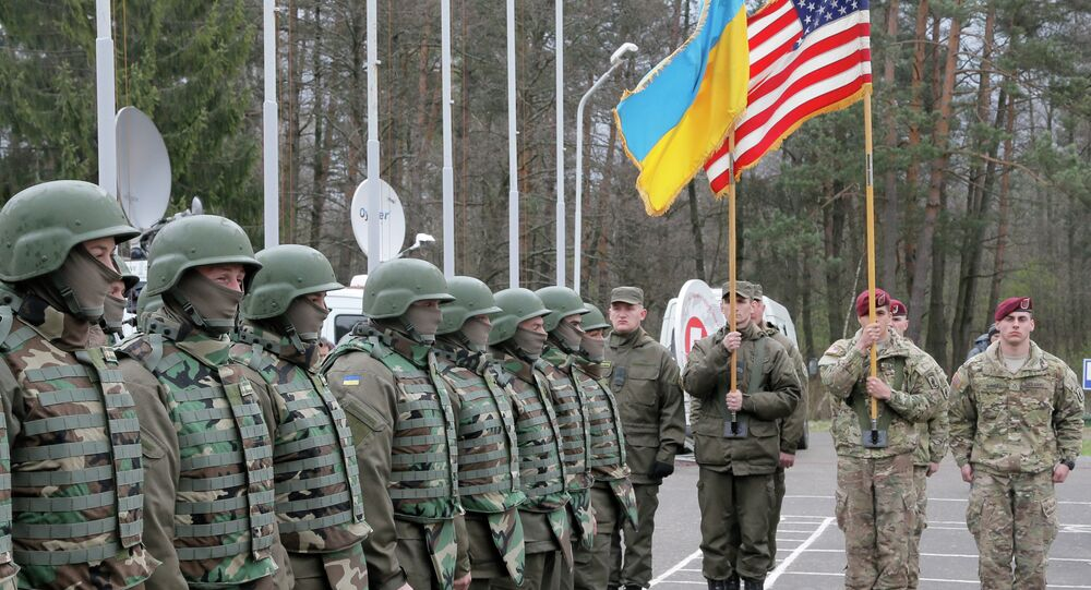 US and Ukrainian soldiers stand guard during opening ceremony of the 'Fearless Guardian - 2015', Ukrainian-US Peacekeeping and Security command and staff training, in western Ukraine, in Lviv region, Monday, April 20, 2015