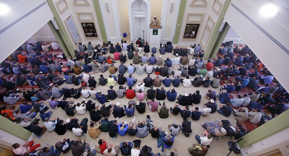 Muslim men praying at a mosque