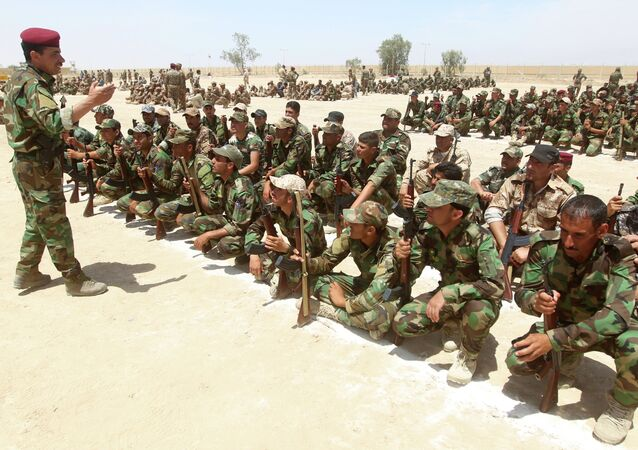 Iraqi Sunni volunteers from the Anbar province, who joined Iraq's Popular Mobilisation force as part of government efforts to make the fight against the Islamic State (IS) group a cross-sectarian drive, take part in their first training session at a training base in Amriyat al-Fallujah, on May 8, 2015