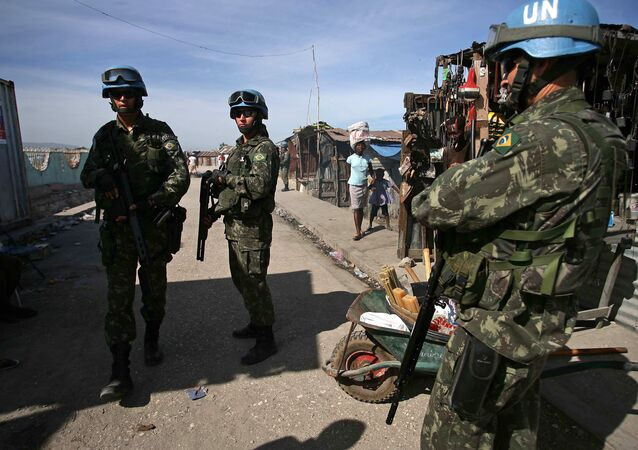 Brazilian UN peacekeepers patrol through Cite Soleil, the biggest slum on the outskirts of the Haitian capital Port-au-Prince, on November 22, 2010