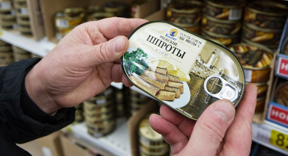 A customer chooses canned sprats in a Moscow supermarket