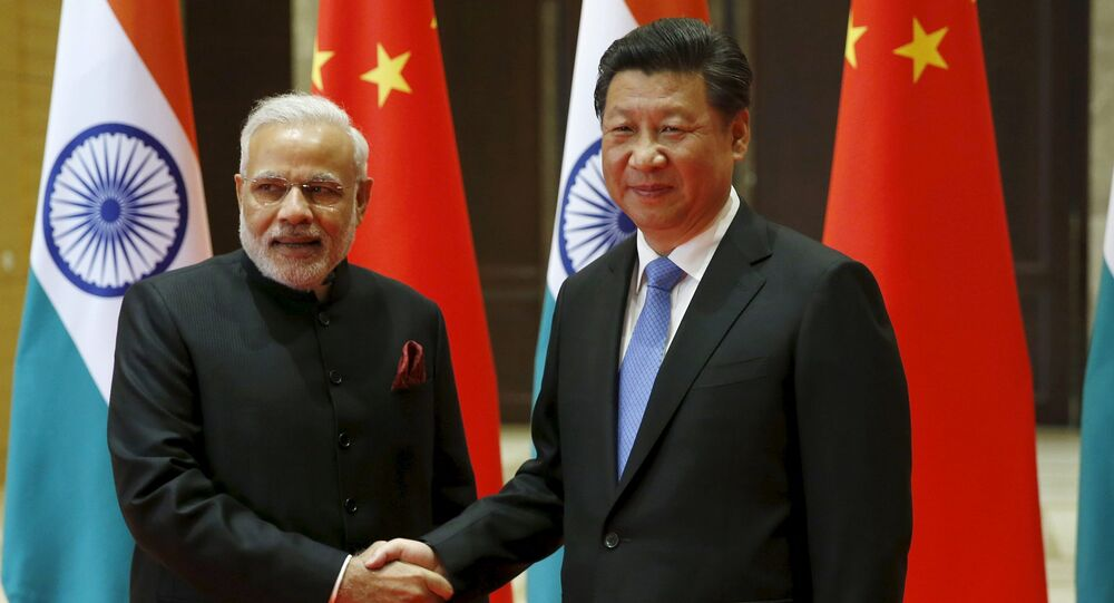 Indian Prime Minister Narendra Modi (L) and Chinese President Xi Jinping shake hands before they hold a meeting in Xian, Shaanxi province, China, May 14, 2015