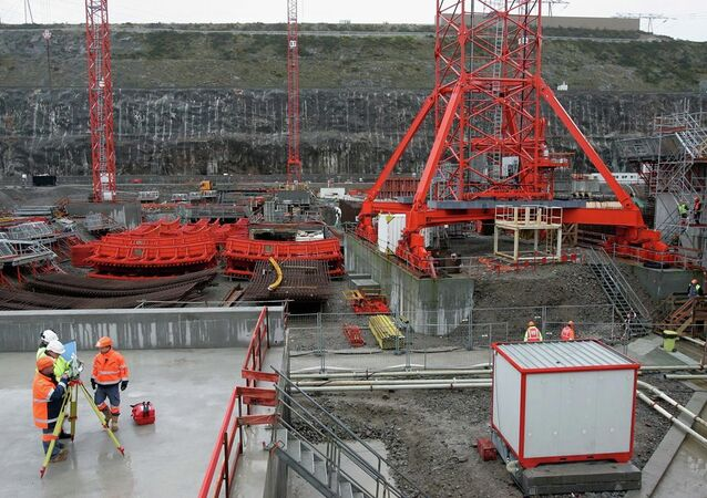 Workers are seen on a construction site of France's first new generation nuclear reactor in Flamanville, northwestern France.
