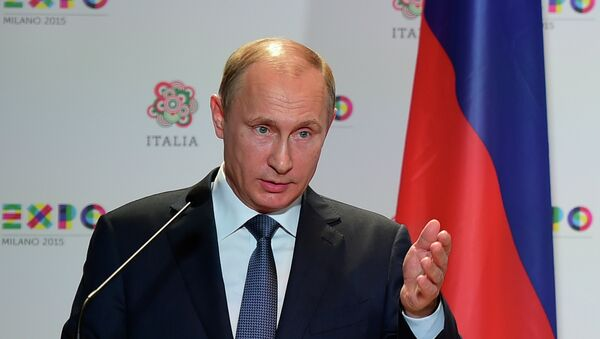 Russian President Vladimir Putin speaks during a joint press conference with Italian Prime Matteo Renzi following their meeting and a visit at the Expo Milano 2015, the universal exhibition, on June 10, 2015 in Milan - Sputnik International