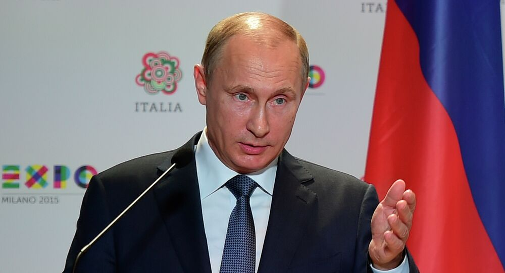 Russian President Vladimir Putin speaks during a joint press conference with Italian Prime Matteo Renzi following their meeting and a visit at the Expo Milano 2015, the universal exhibition, on June 10, 2015 in Milan