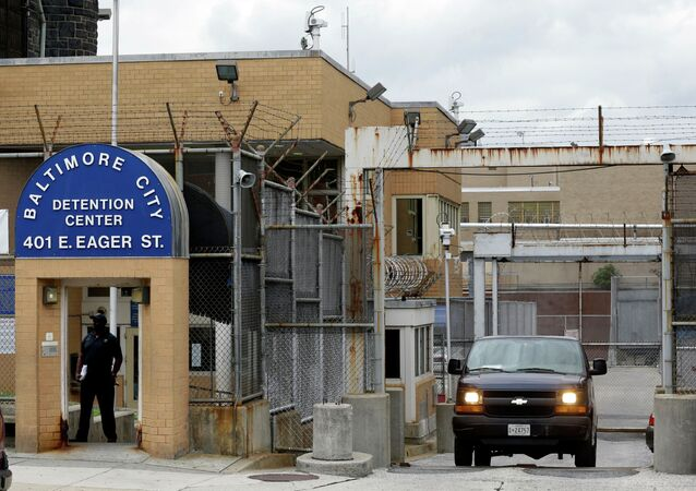Prisoner transport van departs from the Baltimore City Detention Center, in Baltimore