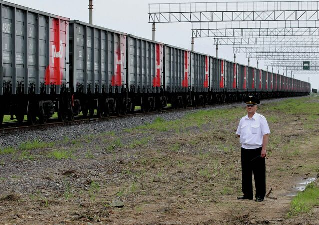 The first freight train crosses the new railway checkpoint between the Russian station Makhalino and Chinese station Hunchun, Jilin province.